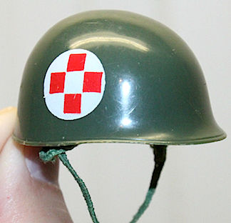 "As great as they are, vintage 1:6 GIjOE helmets typically are too green (not olive drab) and too shiny, one might even say ""glossy."" (Photo: ebay)"