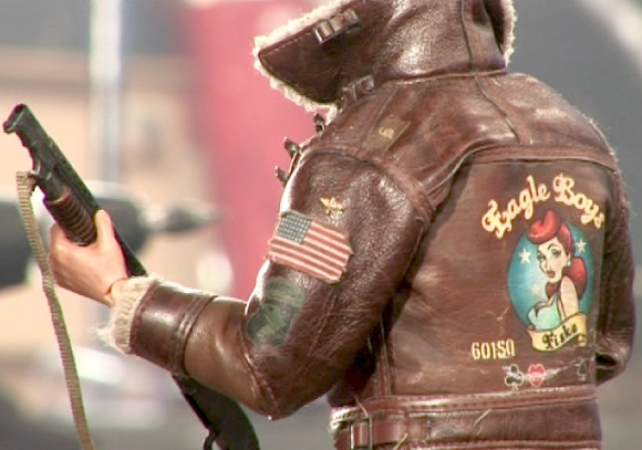 The goof-ball American fighter pilot was another waste of time, predictable and completely unfunny. However, the back of his jacket revealed some nice detailing work, unlike the front, which was a hodgepodge of pilot's pins and other silliness. (Photo: Flatiron Film Co.)