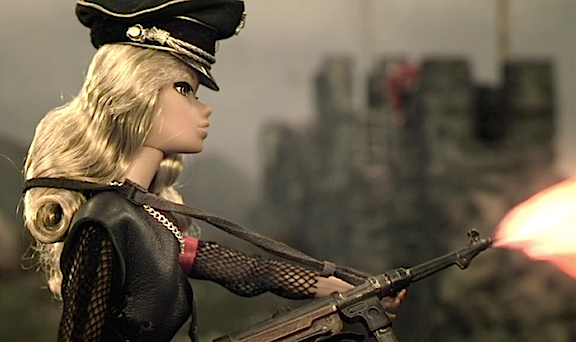 Barbie looks very S&M in her skin-tight Nazi uniform and high-heel Jackboots as she sprays the defenders perched on Hadrian's Wall with her submachine gun. And yet...these scenes could have been SO much better. (Photo: Flatiron Film Co.) Click to enlarge.