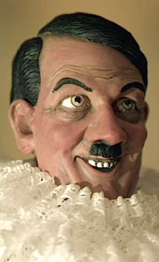 Another attempt at humor using an effeminate Hitler in an Elizabethan dress falls flat with nary a giggle. Monty Python-esque comedy this is NOT. (Photo: Flatiron Film Co.)