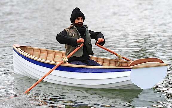 Row, Row, Row Your Boat! Action Man works hard to cross the Thames, whilst ably and remotely controlled by master model boat builder, Jason Quayle of the UK. Absolutely SUPERB! (Photo: Manx Model Boat Club)