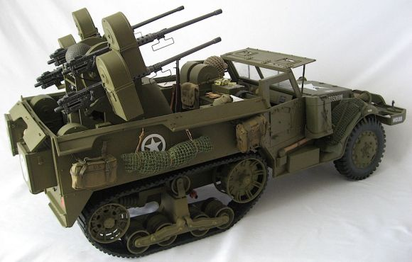 Four, count 'em, FOUR .50 caliber machine-guns mounted on a rotating turret make this stunning custom halftrack by Robert Jason a big, BAD mutha! (Photo: Robert Julie Kostick)