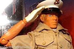 Atten-HUT! After 50 years waiting, it was a pleasure to be able to FINALLY purchase a GIjOE that could actually salute his superior officer. A long time coming, this marvelous Dress Marine could instantly snap a salute by the owner simply pushing down on a lever in his back. The white gloved hand was a nice touch as well. OOHrah! (Photo: ebay)