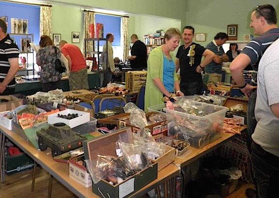 Action Man—Is HERE! Fans of all things Action Man gather 'round a dealer's table to search for 1:6 scale treasure during last year's VAME 4 toy show in the UK. (Photo: vame.freeforums.net)