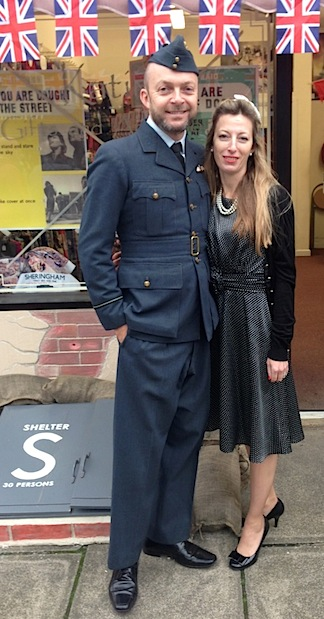 "Action Man fan and collector, Robert Wisdom, poses alongside ""his better half"" for a pic taken at a recent 1940s weekend in Sheringham, Norfolk. The event is held every September in the UK, and according to Robert, ""is a great chance to get out my 1940s Battle of Britain dress uniform and soak up the atmosphere, ride steam trains and marvel at Spitfires flying overhead. Hundreds of US vehicles line the streets too, so it's worth a trip over the pond!"" Sounds like a FANTASTIC time! (Photo: Robert Wisdom)"