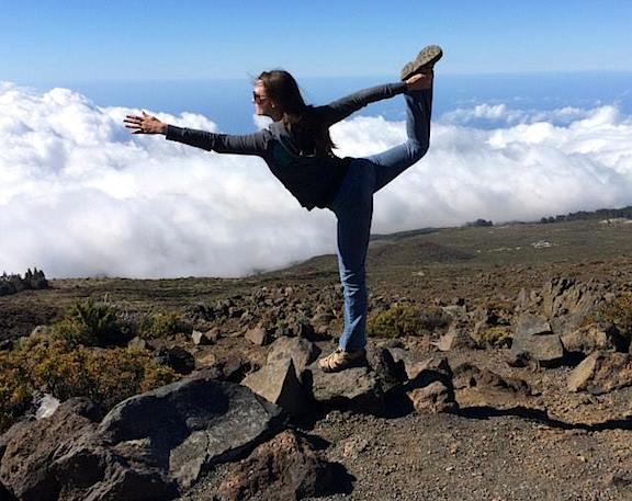 High atop a Hawaiian Volcano, Mary demonstrates her mastery of an elegant (and difficult) yoga pose. (Photo: Mary Votava)