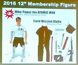 So Far Away! Sorry about this grainy pic, but we were  seated pretty far back in the crowd during this presentation. Regardless, we hope you can make out the fact that Mike now has TWO atomic legs, and an all-new