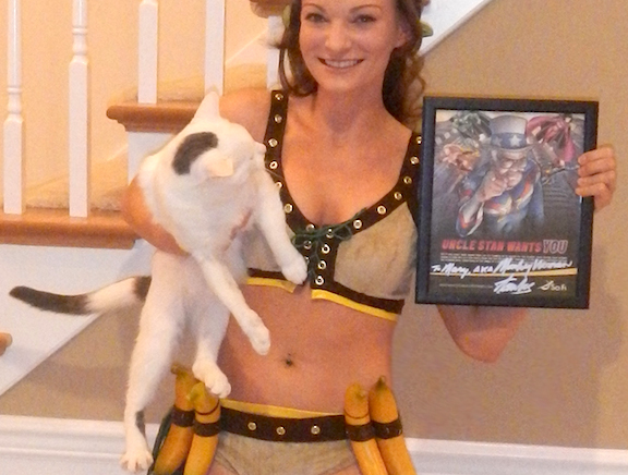 MeOW, Mary!  In this exclusive photo (taken 3/2015) for The Joe Report, Votava redonned her original costume and posed holding this autographed mini-poster from Stan Lee. (Photo: Mary Votava)