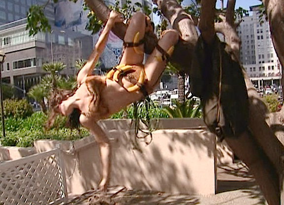 As agile as her namesake, Votava performs a final flip out of the tree in the park. (Photo: Syfy)