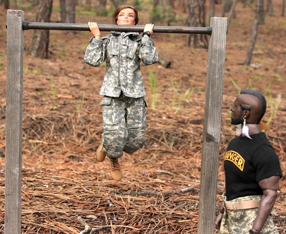 CWO Devereux show Sgt. T she's got what it takes and maxes out each rep. HOOah! (Photo: Steve Benson) Click to enlarge.