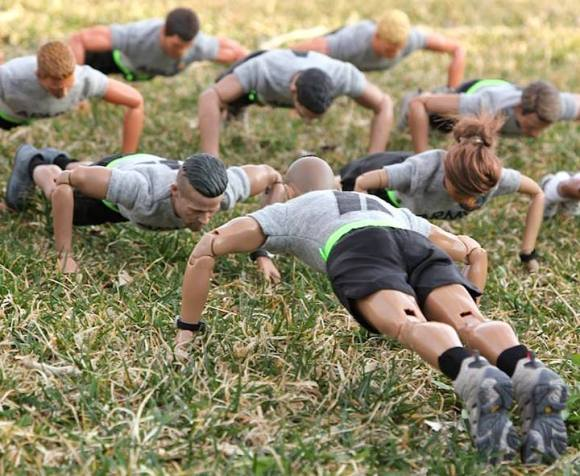 Hit the dirt and gimme 25! The drill sergeant wastes no time in getting the soldiers warmed up and working. (Photo: Steve Benson) Click to enlarge.