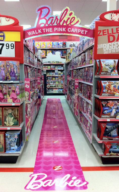 How long has it been since you've seen BOTH sides of the aisle in a toy store devoted solely to Barbies? The famed
