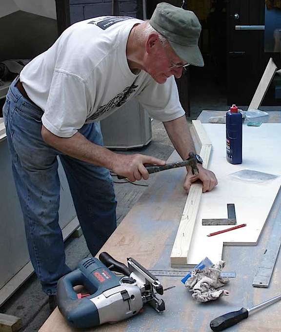 The Master at Work— Peter Shaw, possibly the world's greatest living modeler of 1:6 scale, is shown here working on his most massive and famous achievement, a 1:6 scale version of the infamous WWII