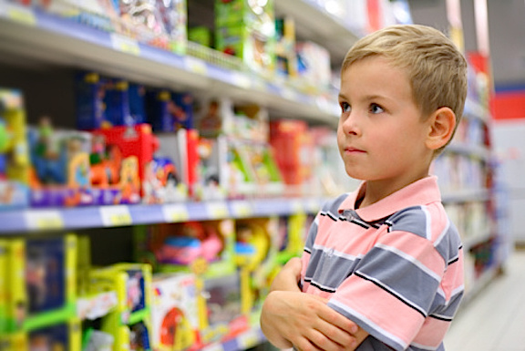Are toys losing their allure? When children walk the aisles of Target, Toys 'R Us and Walmart, are they even interested in what they see? Will the gender-neutralification of aisle colors and displays further reduce the allure of toys for upcoming generations? What is THIS little boy thinking about all this? (Photo: