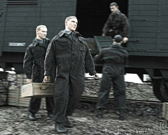 Unidentified men (Polish slaves, perhaps?) loading Shaw's 1:6 scale train with boxes full of, what..? Possibly bars of gold, stolen artwork; who knows? (Photo: KVA)