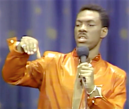 "Eddie Murphy acts out how he used to play with his GIjOE in the bathtub during his famous ""Fart Game"" routine in this screenshot from the 198 stand-up film, Delirious."